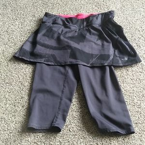 Woman's athletic skirt with leggings attached